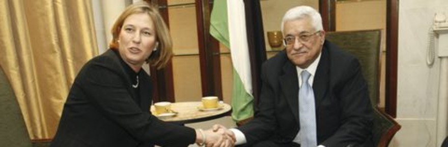 Palestinian President Mahmoud Abbas (R) meets Israeli Minister for Foreign Affairs Tzipi Livni at a hotel in Paris
