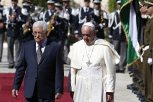 (RNS1-may30) Pope Francis reviews the honor guard with Palestinian President Mahmoud Abbas during an arrival ceremony at the presidential palace in Bethlehem, West Bank on May 25, 2014. For use with RNS-POPE-BETHLEHEM, transmitted on May 30, 2014, Photo by Paul Haring, courtesy of Catholic News Service