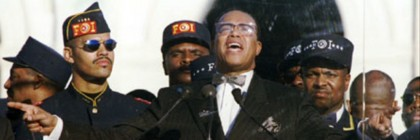 "WAS25:MARCH:WASHINGTON,16OCT95-  Nation of Islam leader Louis Farrakhan addresses hundreds of thousands of marchers at the Mall  during the ""Million Man March"" Oct. 16. Farrakhan said America remains two racially divided societies.         farrakhan's son Mustafa is on left.    vm/Photo  by Mike Theiler REUTERS"