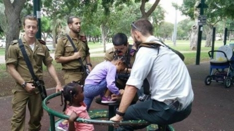 IDF soldiers babysit for illegal alien child